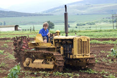 Yellow Vintage Diesel Forty Tractor on Farm Royalty Free Stock Photos