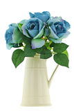 Yellow vintage enamel ceramic jug vase with blue green roses Stock Images