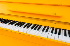 Yellow vintage piano Royalty Free Stock Photography