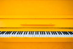Yellow vintage piano Royalty Free Stock Images