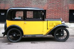 Yellow vintage style car Royalty Free Stock Photos