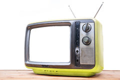 Yellow Vintage TV on wood table Stock Photos