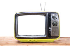 Yellow Vintage TV on wood table Stock Image