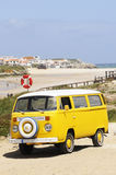 Yellow Vintage Van at the Beach Royalty Free Stock Photography