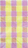 Yellow , violet , pink  checkered tablecloth background Stock Image