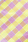 Yellow , violet , pink  checkered tablecloth background Stock Photography