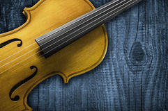 Yellow Violin on grey wooden background. With space for text writing Stock Photos