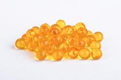 Yellow vitamin capsules Royalty Free Stock Image