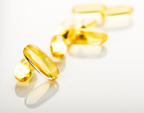 Yellow vitamin e fish oil capsule Royalty Free Stock Photo