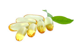 Yellow vitamin omega3 fish oil capsule on white background Stock Photo