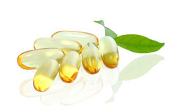 Yellow vitamin omega3 fish oil capsule on white background.  Royalty Free Stock Image