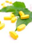 Yellow vitamin pills Stock Photo
