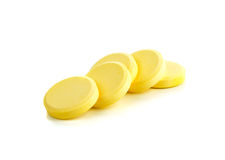 Yellow vitamin pills Stock Images