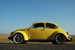 Yellow Volkswagen beetle Royalty Free Stock Images
