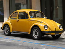 Yellow Volkswagen Beetle Stock Photography