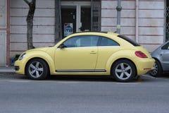 Yellow Volkswagen New Beetle Stock Photos