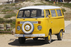 Yellow Volkswagen Vintage Van - Summer - Beach Stock Image