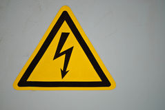 Yellow Voltage Warning Sign Royalty Free Stock Photos