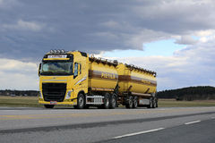 Yellow Volvo FH Tank Truck in Bulk Transport along Highway Royalty Free Stock Images