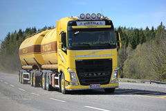 Yellow Volvo FH Tank Truck on Spring Road Royalty Free Stock Images