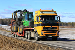 Yellow Volvo FH Transports Forest Machinery royalty free stock photography
