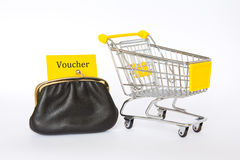Yellow voucher wallet shopping trolley Stock Images