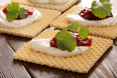 Yellow waffle with white cottage cheese cherry jam and fresh her Stock Images