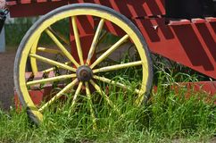 Yellow Wagon Wheel Near Woodburn, Oregon. This is a yellow wagon wheel on the Wooden Shoe Tulip Farm near Woodburn, Oregon Stock Photo
