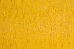 Yellow wall. Painted textured yellow wall background Royalty Free Stock Photo