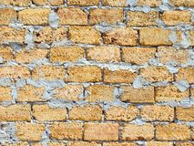 Yellow wall background. Shell rock brickwall texture background pattern Stock Photo
