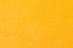 Yellow wall background. Outdoor yellow concrete rough wall background Stock Image