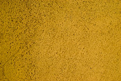 Yellow wall background texture Stock Images