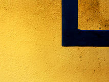 Yellow Wall Black Right Angle. Yellow and Orange speckled wall with a black right angle and space for text Royalty Free Stock Photo