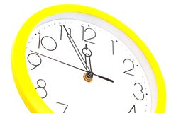 Yellow wall clock Royalty Free Stock Photo