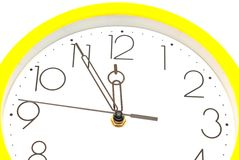 Yellow wall clock Stock Photo