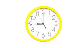 Yellow wall clock Royalty Free Stock Image