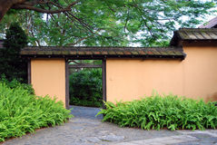 Yellow wall in the garden. Secret garden with yellow wall Royalty Free Stock Photos
