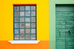 Yellow wall and green door in Burano island, Venice, Italy. Yellow wall and green wooden door in Burano island, Venice, Italy Royalty Free Stock Photo