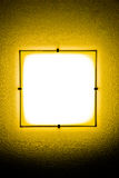 Yellow wall lamp in the darkness. Yellow lamp in the darkness Stock Photography