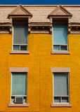 Yellow wall in Montreal. Typical old house in Montreal, Canada. Camera: Nikon D50, 50mm portrait lens Royalty Free Stock Photos