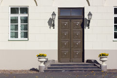 Yellow wall and old brown  wooden door Royalty Free Stock Photo