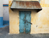 Yellow wall and old locked door. Medina, Tangier Royalty Free Stock Photos