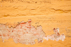 Yellow wall. Old peeling wall painted in yellow color Stock Photos