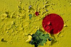 Yellow wall with peeling paint and colorful bright red circles. Yellow wall with the peeling paint and colorful bright red circles stock photo