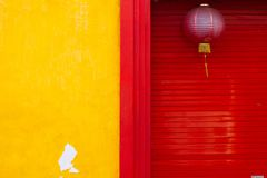 Yellow wall and red door. Yellow wall and red rolling door of chinese house in chinatown at ketandan village, yogyakarta, indonesia royalty free stock photography