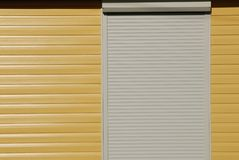 yellow  wall, siding and shutters Stock Photo