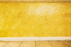 Yellow wall texture, abstract background. Stock Photos