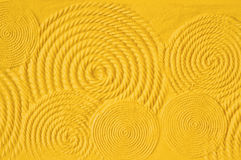 Yellow wall texture Stock Images
