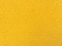 Yellow wall texture background. Textured concrete plaster with spraying in the form of drops Royalty Free Stock Image