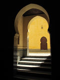 Yellow wall with traditional arc, Morocco, Meknes. Tomb of Moulay Ismail. Traditional Moroccan doorway with stairs and shadow Royalty Free Stock Photography